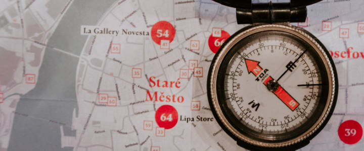 Compass on a map of Prague's old town